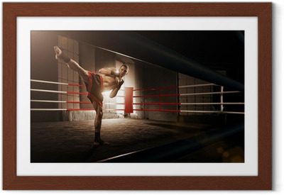 Young man kickboxing in the Arena Framed Poster