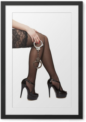 Beautiful woman legs in high heels and handcuffs Framed Poster