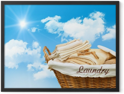 Laundry basket with towels Framed Poster